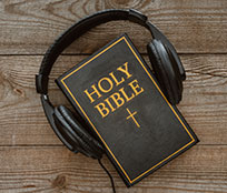 A smartphone and headphones to listen to a daily audio Bible reading as part of a Bible study.